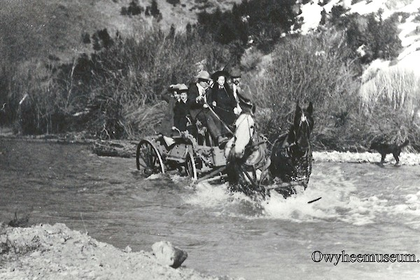 Team and Wagon Crossing Jordan Creek